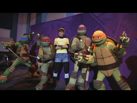 April O'Neil and the Teenage Mutant Ninja Turtles dance with and meet guests at Nickelodeon Suites