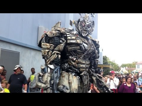 Megatron talks to guests outside Transformers: The Ride attraction at Universal Orlando