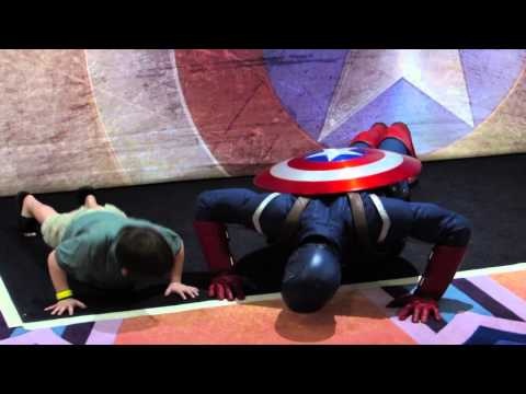 Captain America does pushups with boy on Disney Magic cruise ship