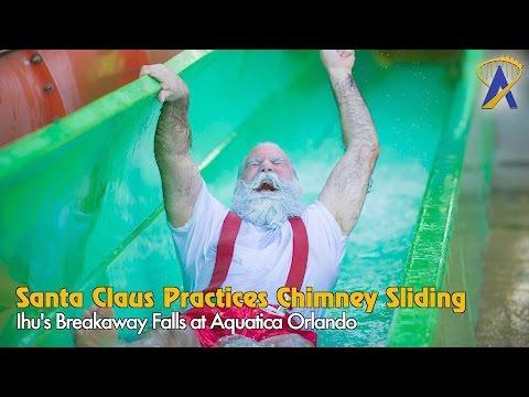 Santa Claus Practices Chimney Sliding on Ihu's Breakaway Falls at Aquatica Orlando