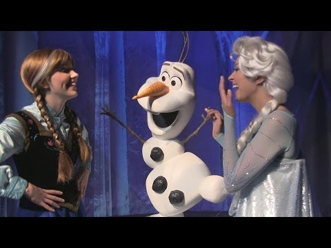 Anna & Elsa from Frozen pose with Olaf and guests at special party