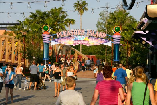 A new banner has been added to the Pleasure Island sign telling of the new Celebrate Tonight! street party. Video screens have also been installed throughout.