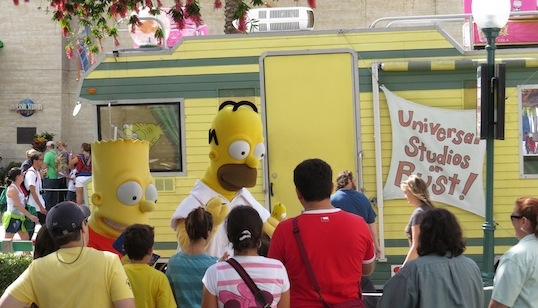 Homer and Bart Simpson eeting guests at Universal Studios Florida.