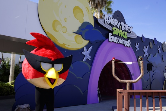 An angry Bird character stands outside the new Angry Birds Space Encounter attraction.