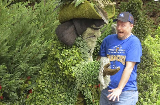 Captain Hook topiary scares a guest at Epcot.