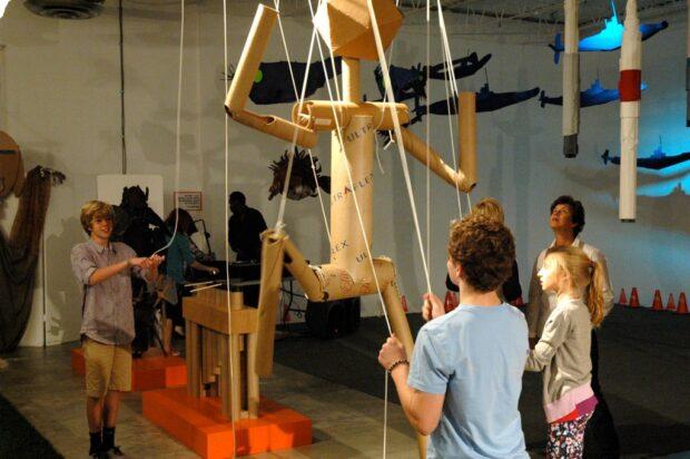 Giant cardboard marionette stickperson