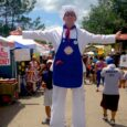 stilt character baker at pie festival in Celebration