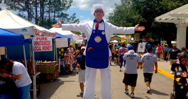 stilt character baker at pie festival in Celebration