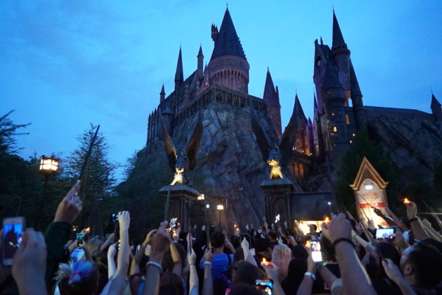 raising wands at Hogwarts castle