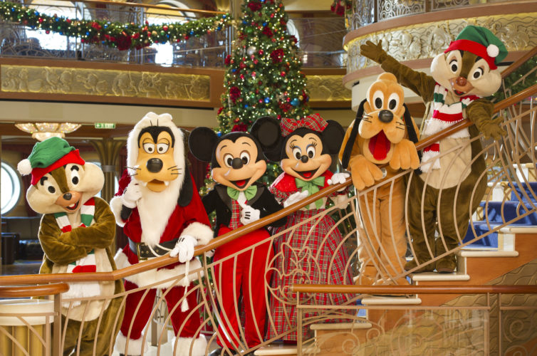 """In the spirit of holiday cheer, Disney Cruise Line adds sparkle to each ship during Very Merrytime Cruises, with Disney characters dressed in festive attire, special stem-to-stern holiday events, traditional """"turkey day"""" fanfare, Christmas feasts, """"snow flurries"""" and New Year's Eve galas. (Kent Phillips, photographer)"""