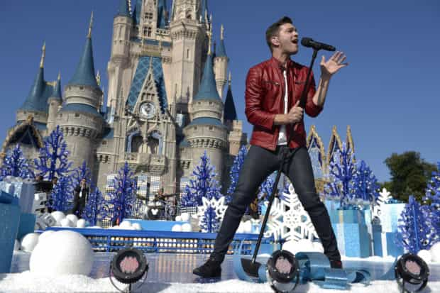 Andy Grammer performs Nov. 12, 2015 during the taping of the 'Disney Parks Unforgettable Christmas Celebration' TV special at Magic Kingdom.