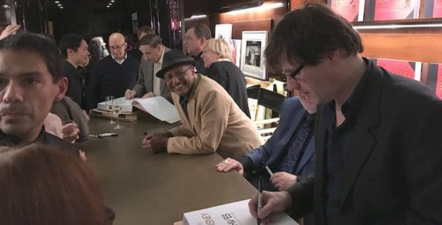 "Disney animator Floyd Norman looks on as other artists and composers sign copies of ""The Walt Disney Film Archives: The Animated Movies 1921-1968"". Photos by Sarah Sterling."