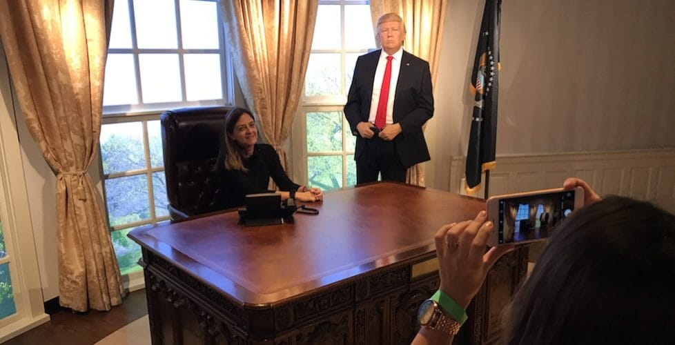 A guest at Madame Tussauds Orlando has her photo taken with the new wax figure of Donald Trump in the recreation of the Oval Office.