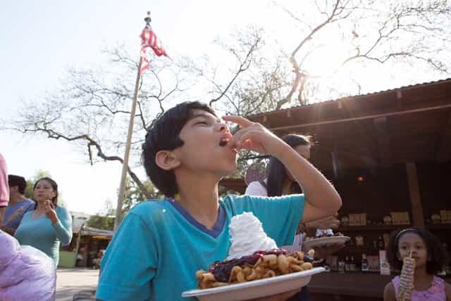 boy-eating-funnel-cake