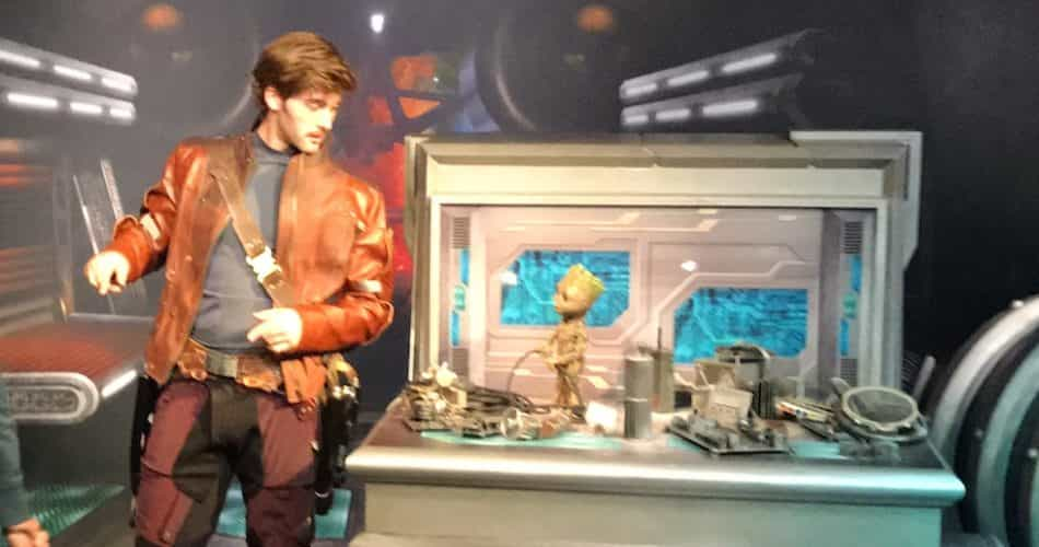 Star-Lord and baby Groot meeting guests.