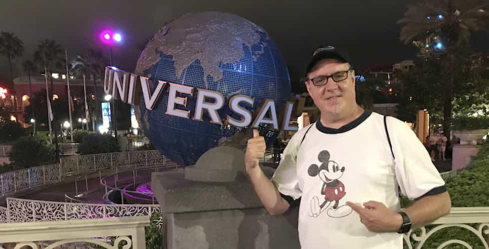 Someone wearing a mickey mouse short at Universal.