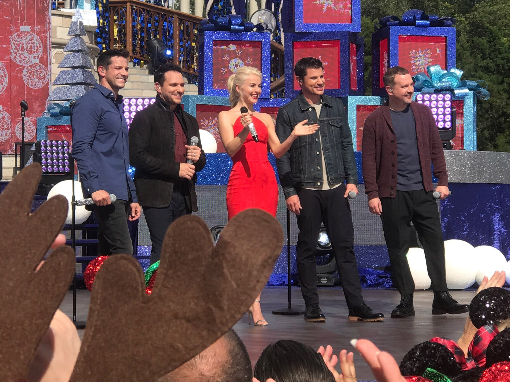 host julianne hough with 98 degrees at the taping of the 2017 disney parks magical christmas celebration