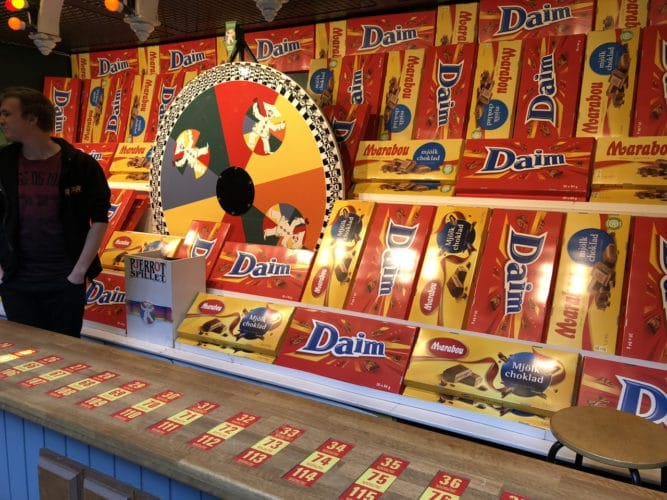 carnival game with huge candy bars as prizes