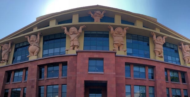 babce21c3a The Team Disney Building is the first building guests and employees see  when they enter the lot. The Seven Dwarf statues at the top of the building  stand ...