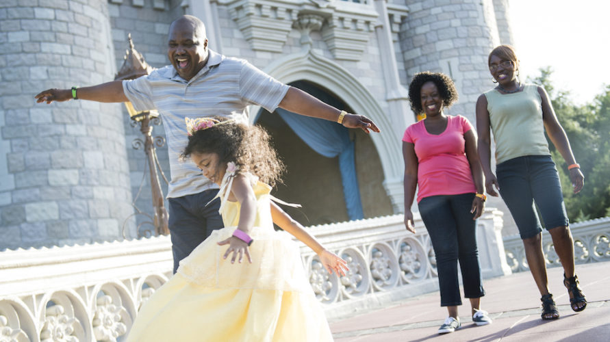 guests in front of cinderella caste without face masks