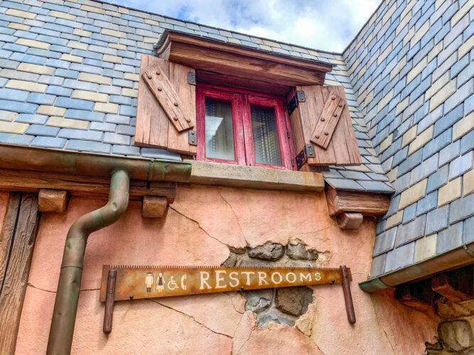Restrooms signage in Belle's village.