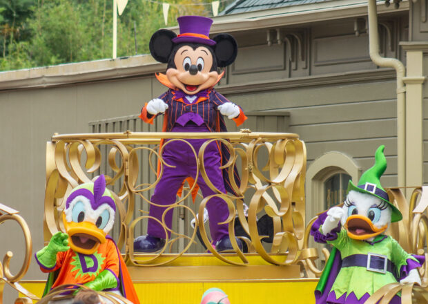 Mickey, Donald and Daisy wave to guests as their Cavalcade comes to the end of the route.