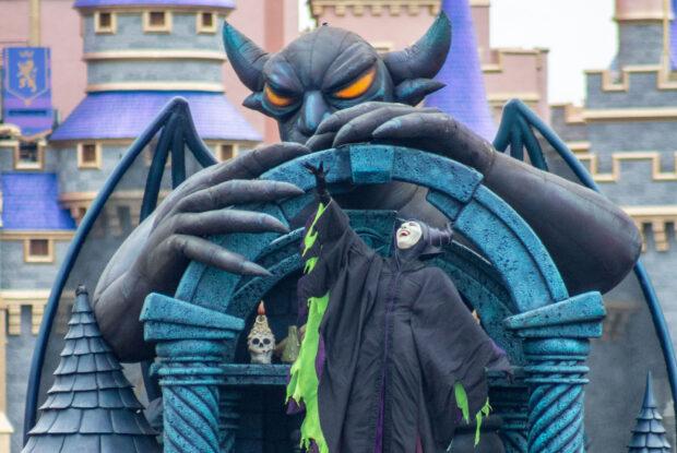 Maleficent heads down Main Street U.S.A. on a Chernabog themed Villains float.
