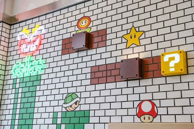Instagram worthy photo wall inside the Mario Cafe.