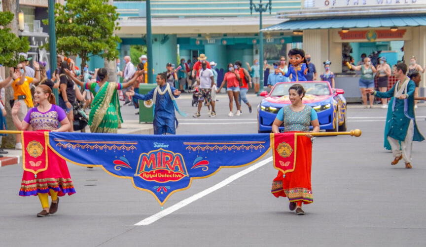 Mira, Royal Detective is lead and accompanied by a banner and set of performers.