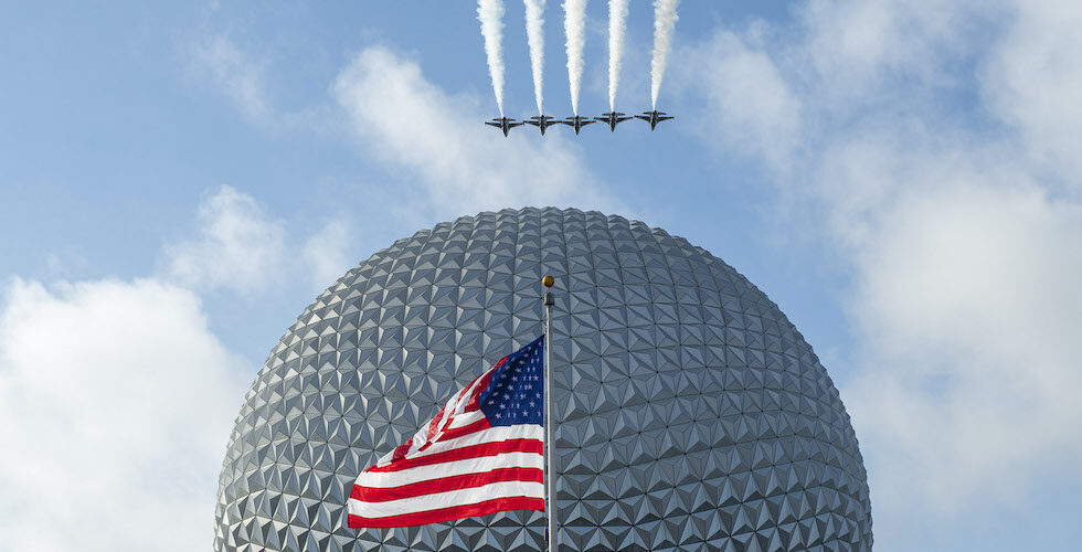 American flag at epcot with Thunderbirds flying over.