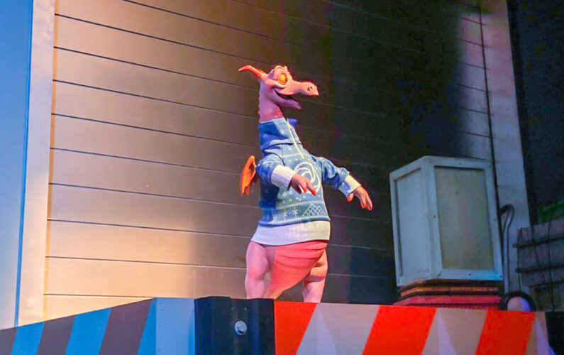 Figment in a christmas sweater.