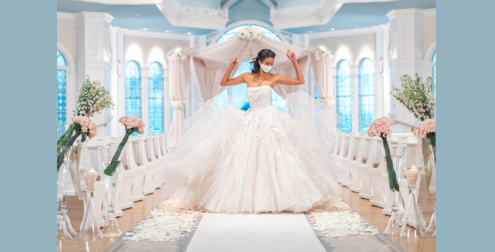 A bride wears one of the new Belle gowns from the Allure Bridal and Disney Weddings collaboration.
