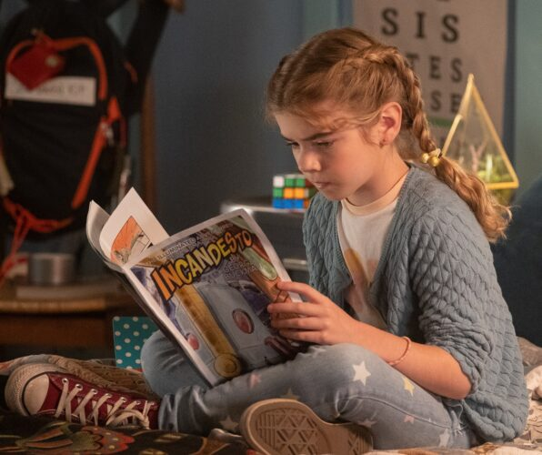 Flora reading a comic book.