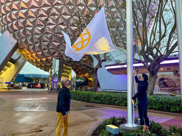Park entrance icon flags being put in place by Walt Disney Imagineering.