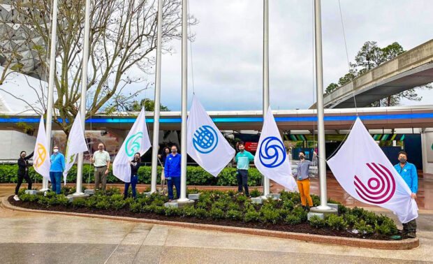 Epcot icon flags being raised.