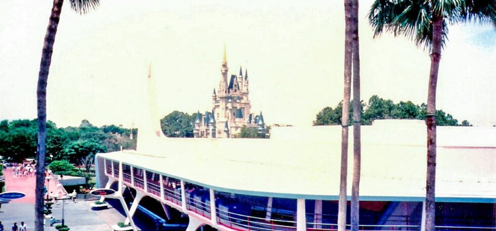 A shot of Tomorrowland from 1993, showcasing the Tomorrowland Transit Authority PeopleMover and the older look of Cinderella Castle.