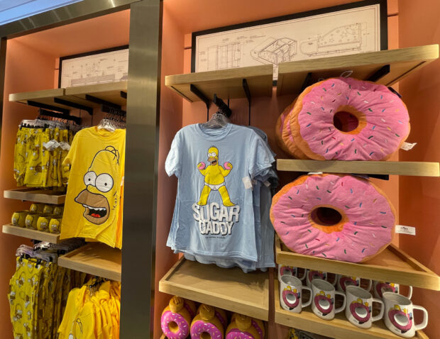 Simpsons section with shirts, pillows and ride schematics.