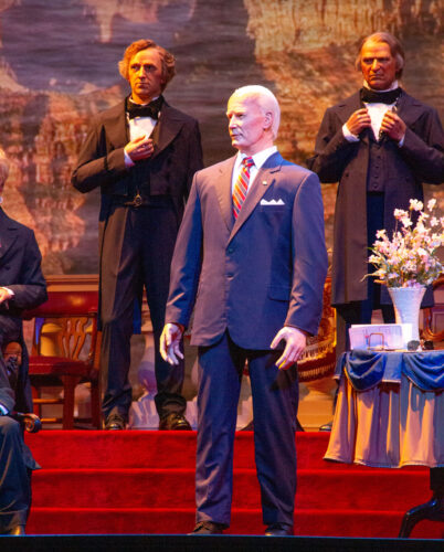 Joe Biden full stature as he stands center stage among America's past presidents.
