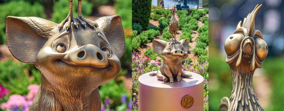 Pua and Heihei are buddied up in their golden character statue at World Showcase.
