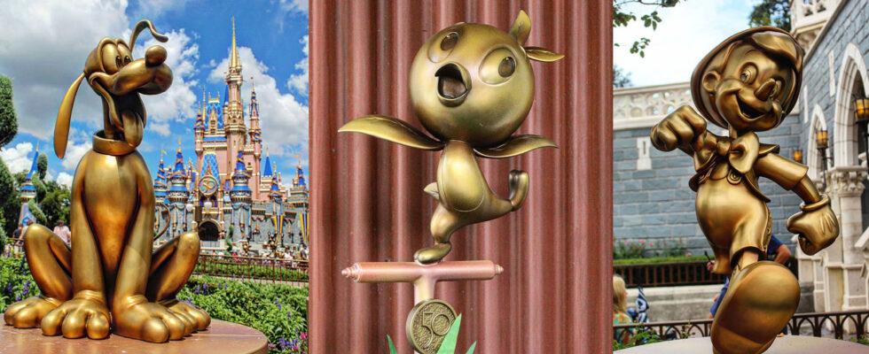 Pluto, Orange Bird and Pinocchio fab 50 statues at Epcot.