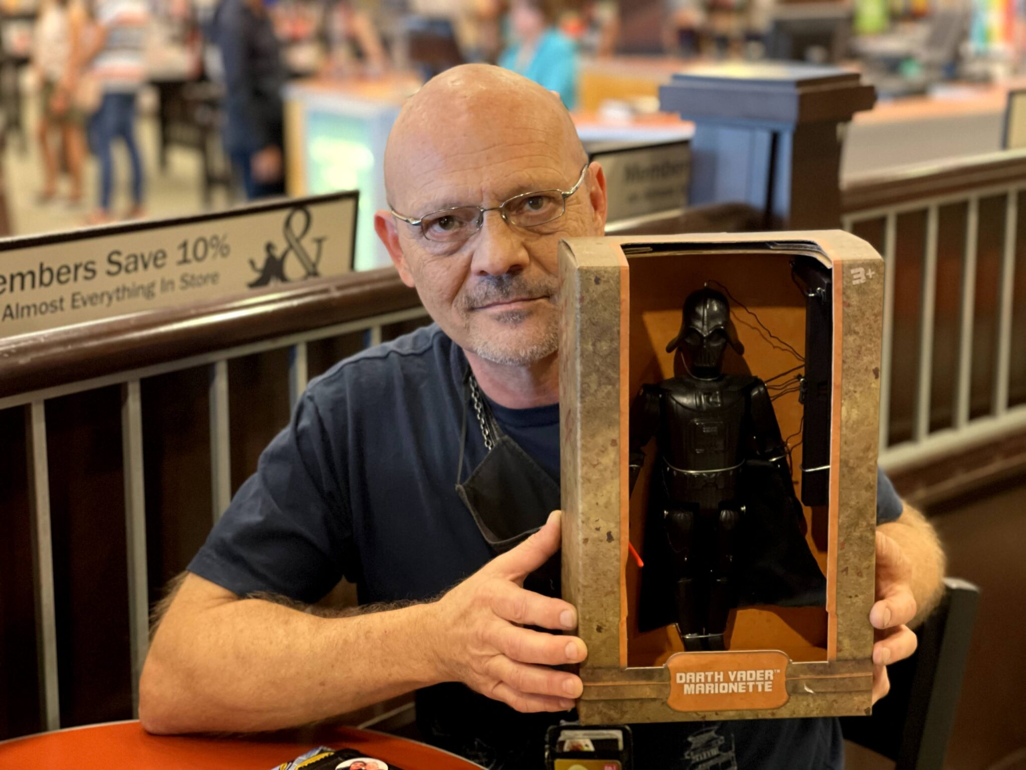 Props designer David Hyde with Darth Vader Marionette toy from Star Wars Galaxy's Edge